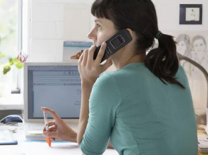 Woman at a desk on a phone